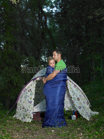 couple embracing in a sleeping bag