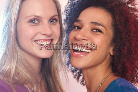 portrait of two young women laughing