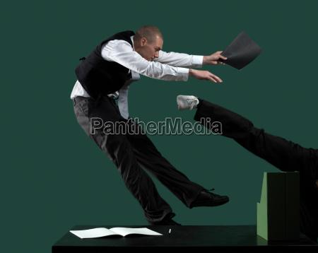 business men fighting