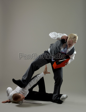 business man fighting over paper holder