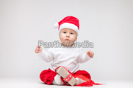 adorable baby wearing a santa hat