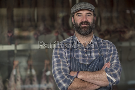 portrait of confident butcher in butchery