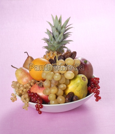 a fruit arrangement with pineapple and