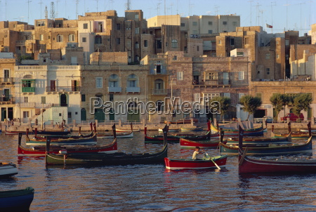 boats moored in valletta harbour at