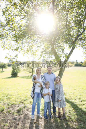 happy young family with 3 children