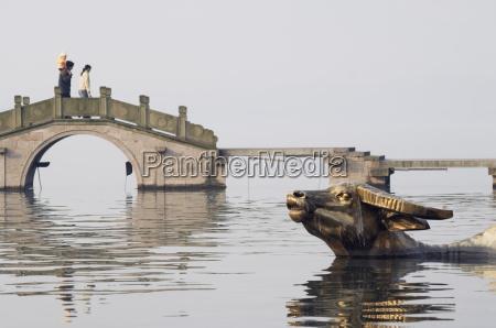 statue of a golden water buffalo