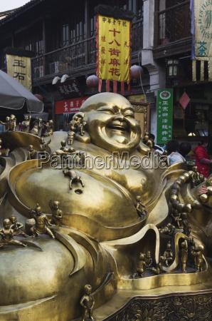 a golden statue of a reclining