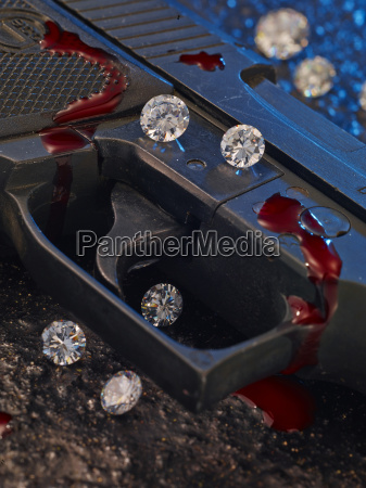 disparador da pistola com diamantes e