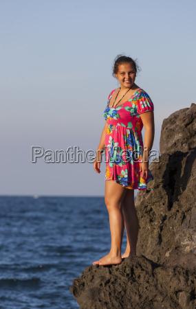 indoneisa teenage girl standing on rock