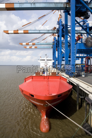 germany bremerhaven red containership docked on