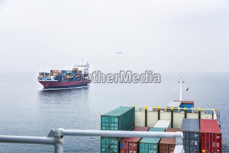 germany hamburg container ship with aeroplane