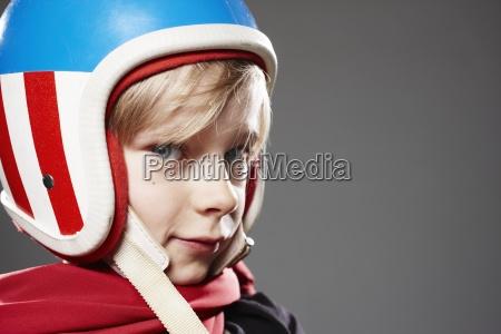 portrait of boy with racer helmet