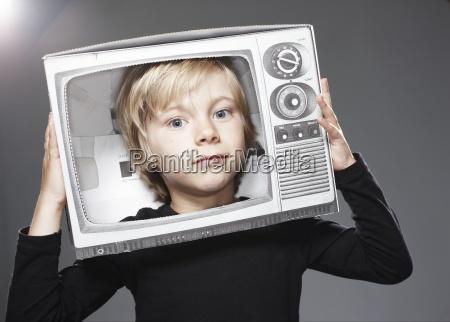 portrait of boy head in paper