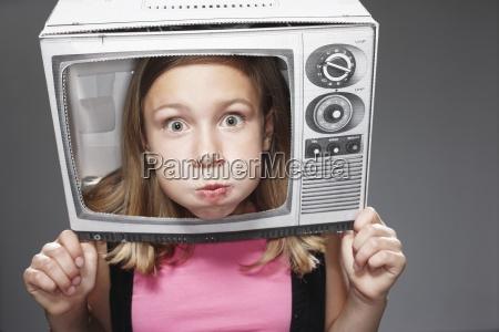 girl surprised in paper tv against
