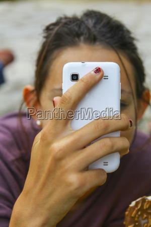 france teenage girl using smartphone close