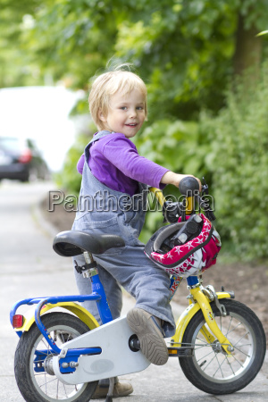 portrait of girl with bicycle smiling