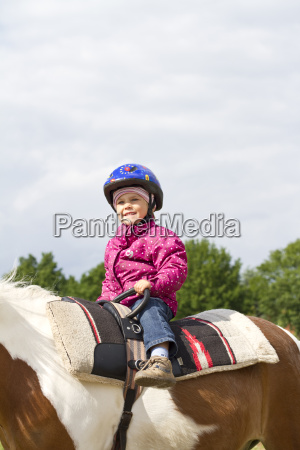germany girl riding horse smiling