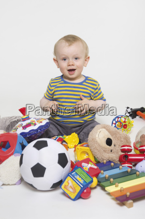 portrait of baby boy playing with