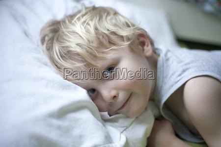 portrait of little boy lying in