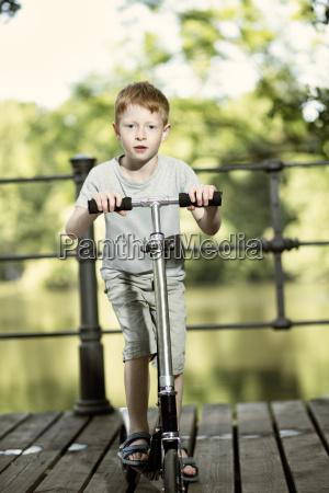 portrait of little boy with push