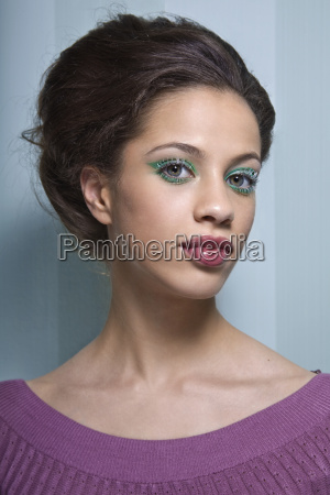 portrait of young woman with green