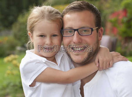 portrait of father and his little