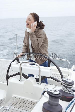 young woman at ships wheel