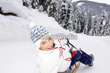 boy on sledge smiling portrait