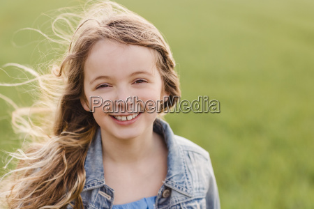 portrait of smiling girl with blowing