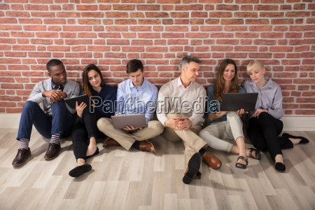 businesspeople using laptop and digital tablet