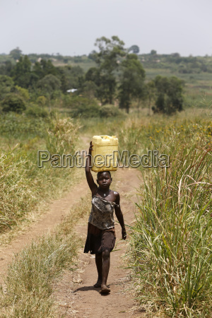 ugandan child fetching water masindi uganda