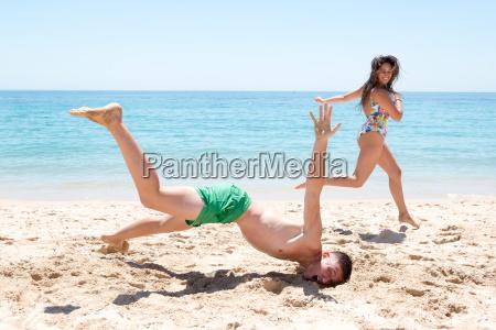boy falling in the beach