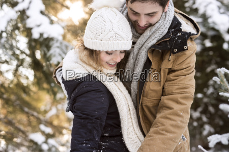happy young couple in snow covered
