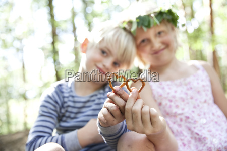 boy and girl in forest holding