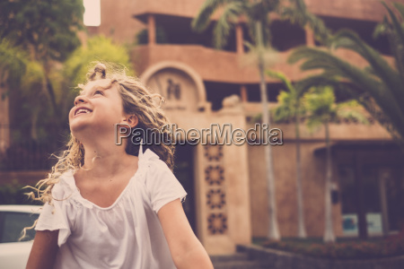 happy blond girl looking up