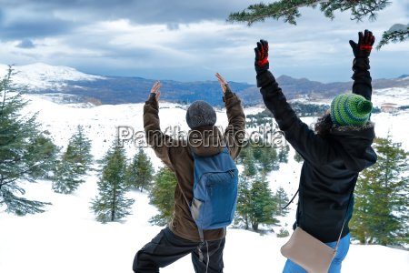 two friends enjoying winter holidays