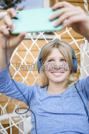 portrait of laughing girl with headphones