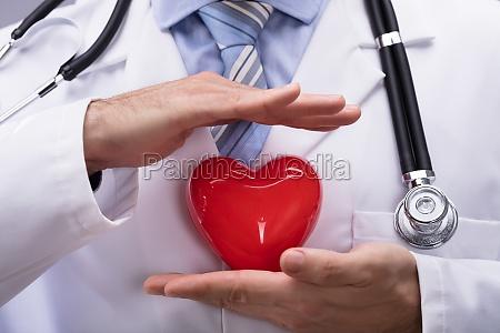 doutor, que, protege, a, forma, vermelha - 23792120
