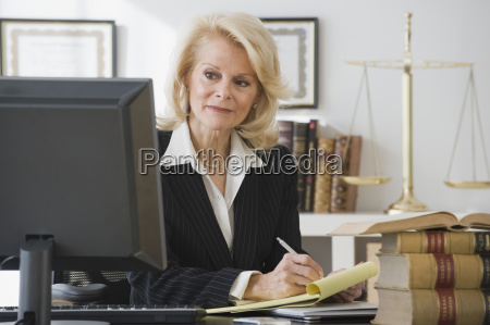 businesswoman writing on notepad