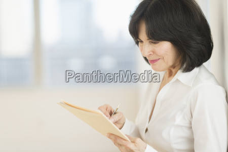 portrait of senior businesswoman writing