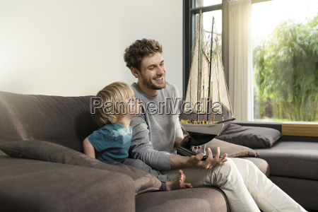 father and son with toy model