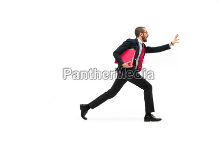 businessman running with a folder on