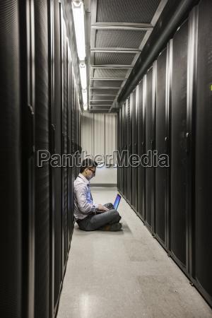 hispanic man technician doing diagnostic tests