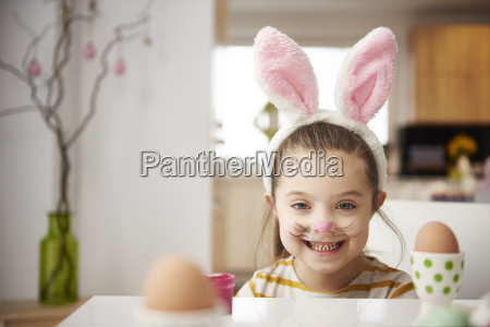 portrait of smiling girl with bunny
