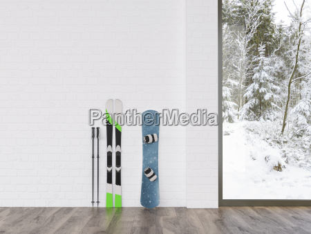 esquis e snowboard em uma parede