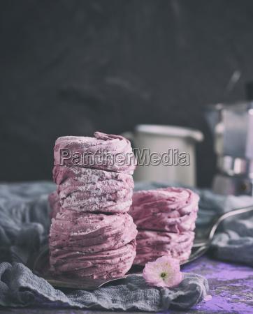 round pink marshmallow on an iron