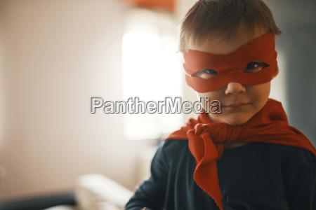portrait of funny little boy dressed