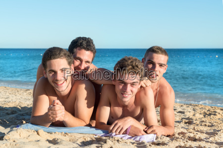 boys having fun at the beach