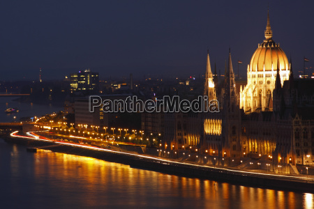 night lights of parliament building beside