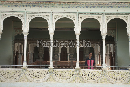 latticed balcony along a courtyard of